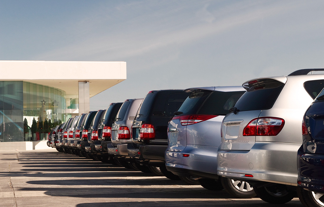 Row of vehicles at a car dealership.