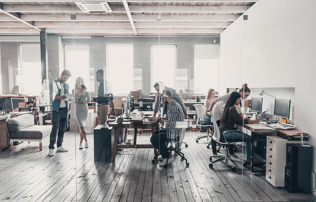 Open office with many workers collaborating