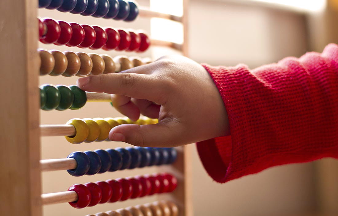 Child hand playing with an abacus