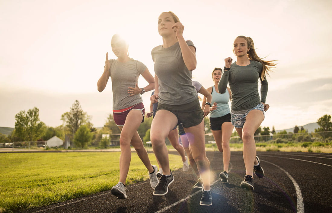 teenage girls running on a track