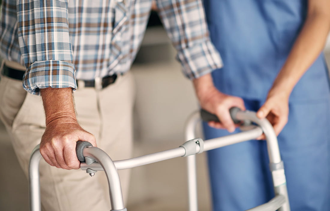 Image of elderly person with walker