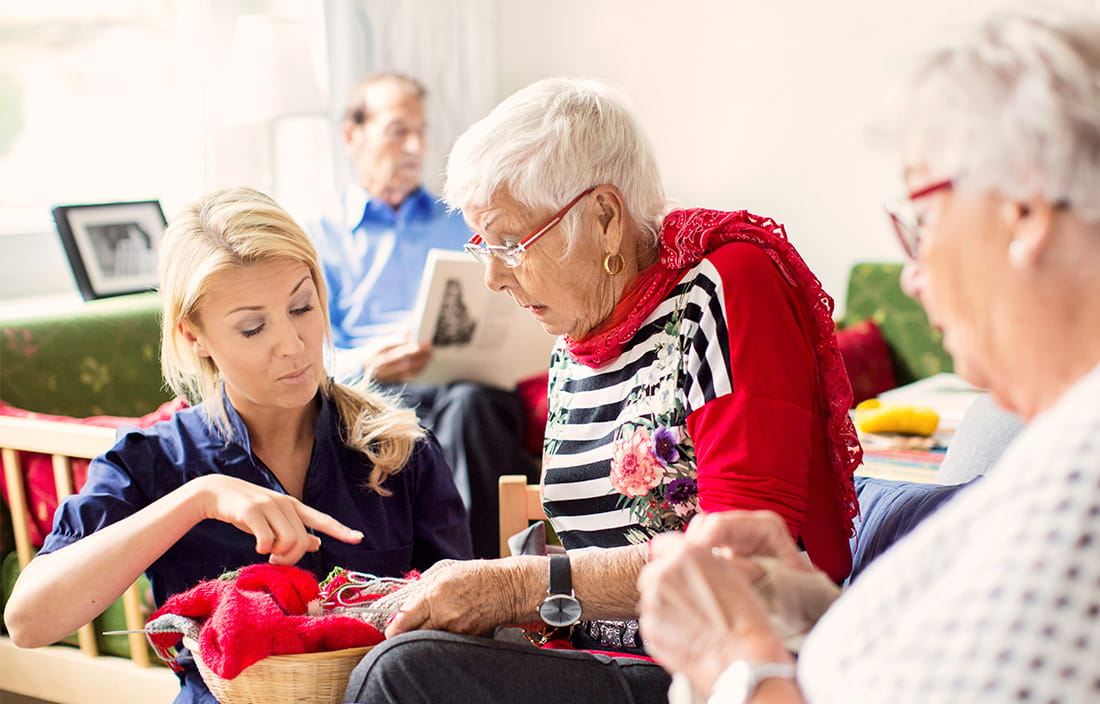 image of care giver helping an elderly woman
