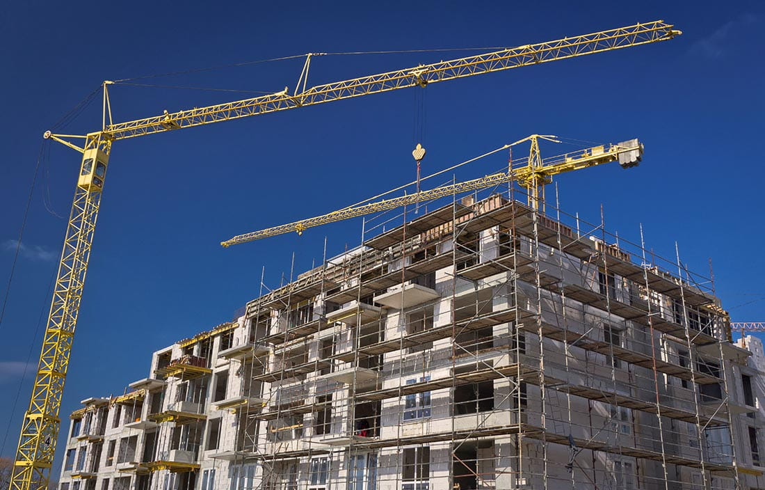 Construction of an apartment with cranes