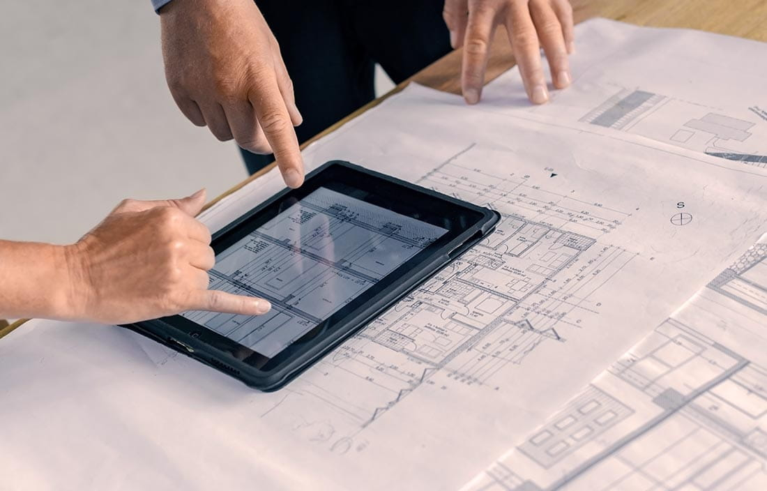 Senior living architects change design plans on a tablet for senior living residence due to COVID-19