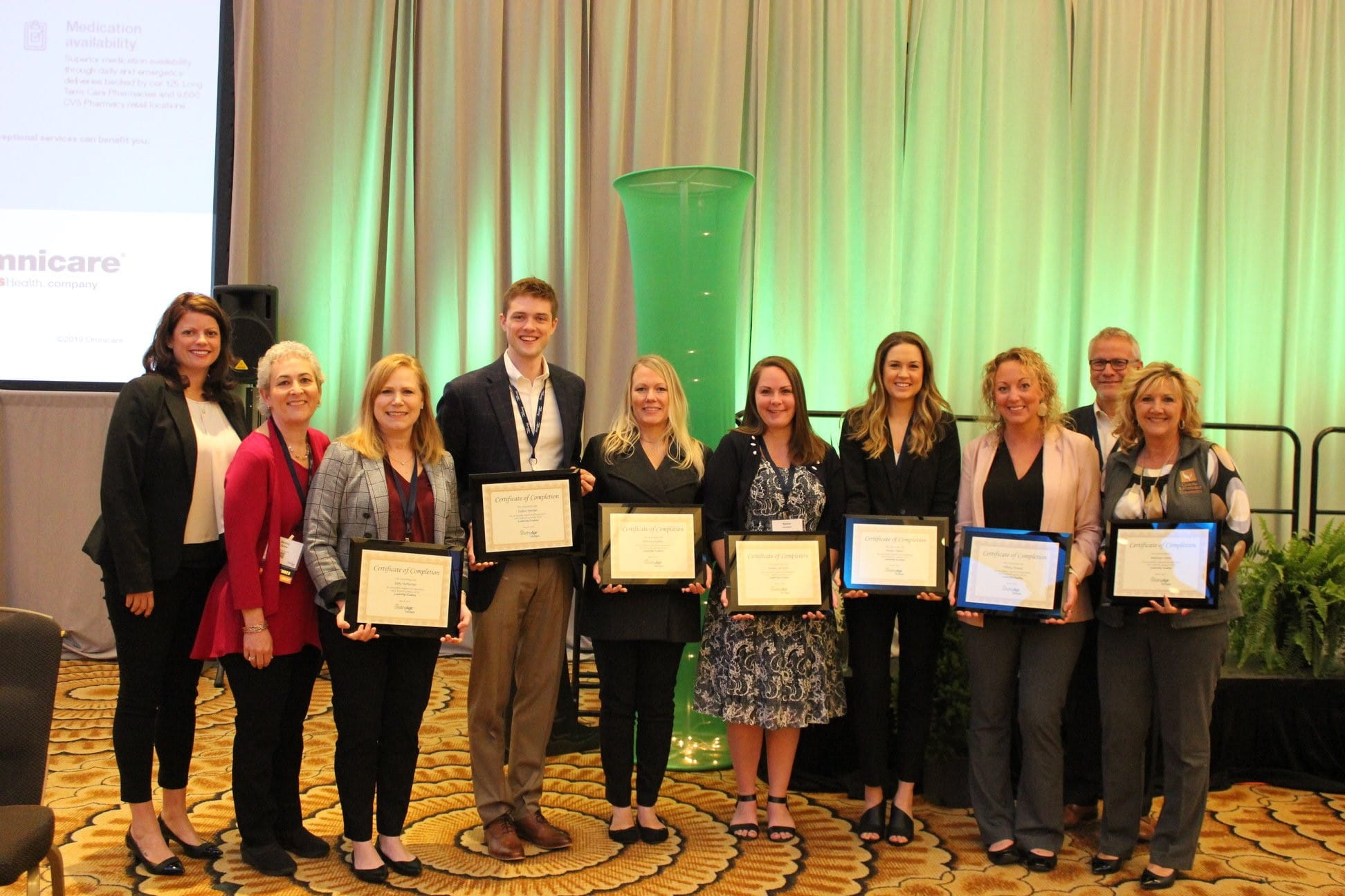 Sally Heffernan and members of the 2019 LeadingAge Michigan Leadership Academy program showing off their certificates