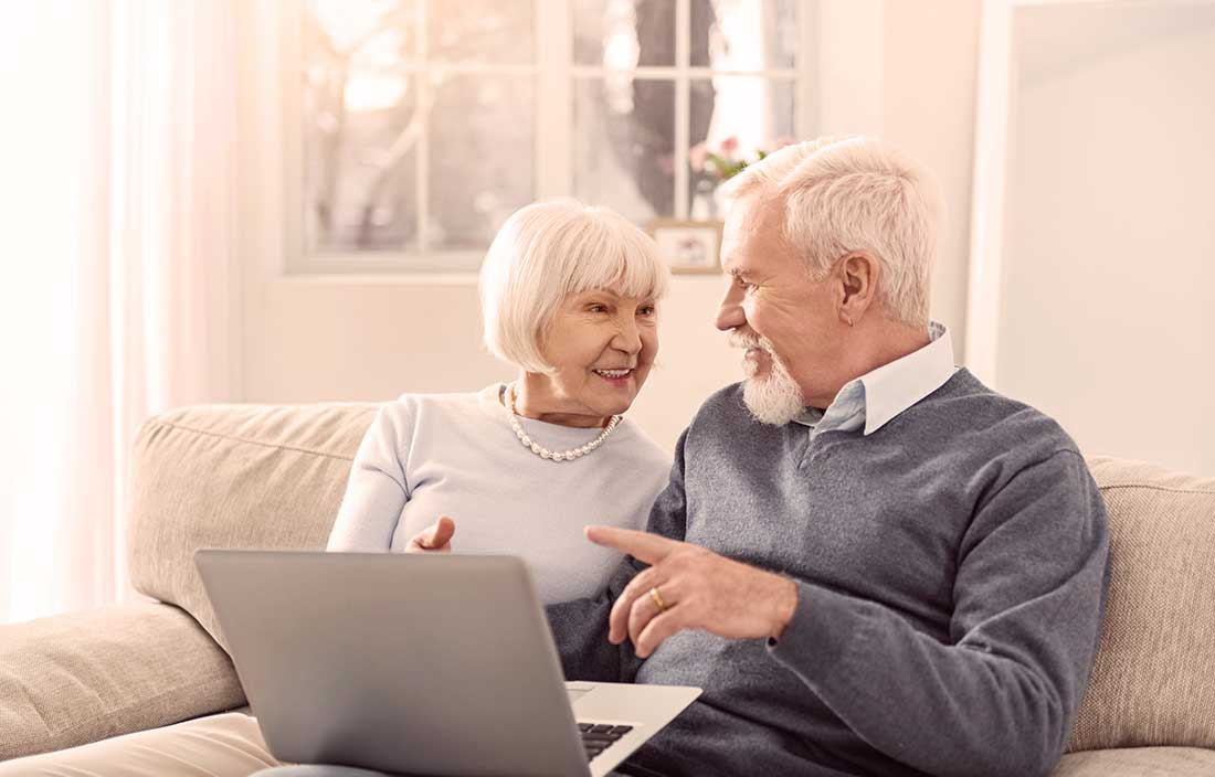 Senior couple looking online for senior housing options during COVID-19