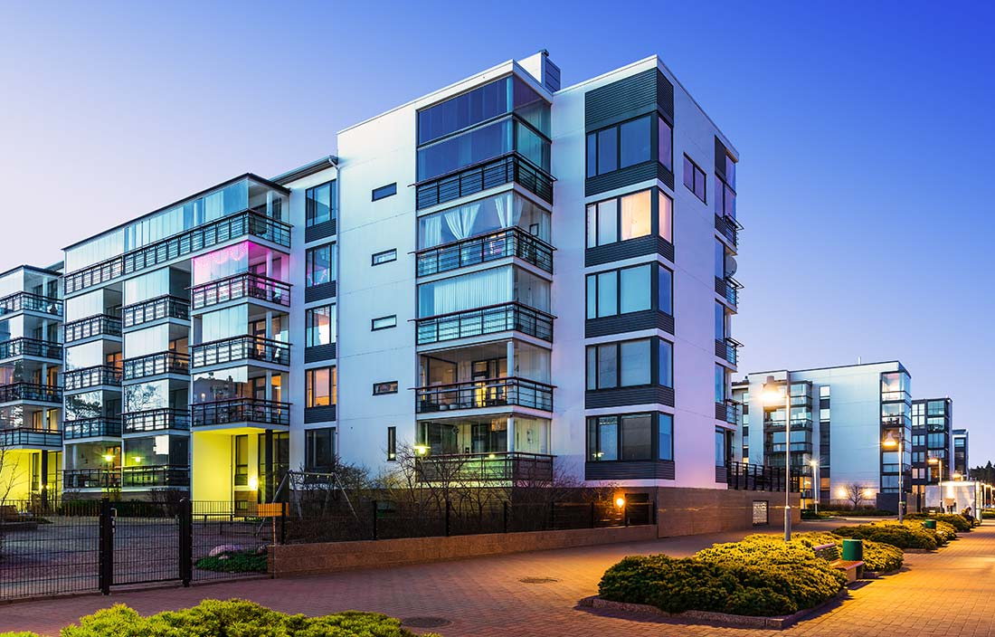 Photo of a modern, urban senior living development or apartment at dusk