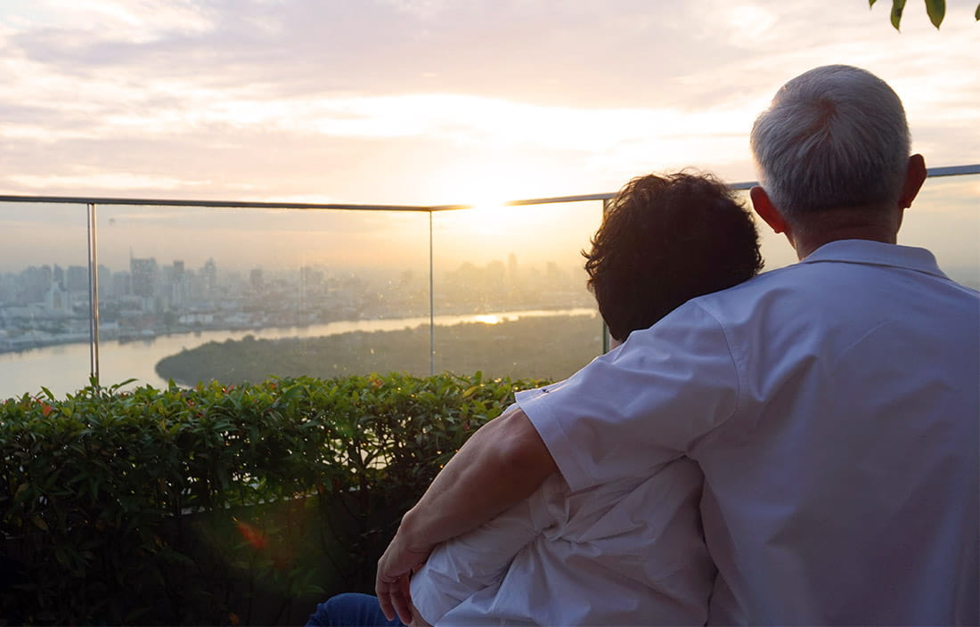 Image of senior man and woman watching sunset