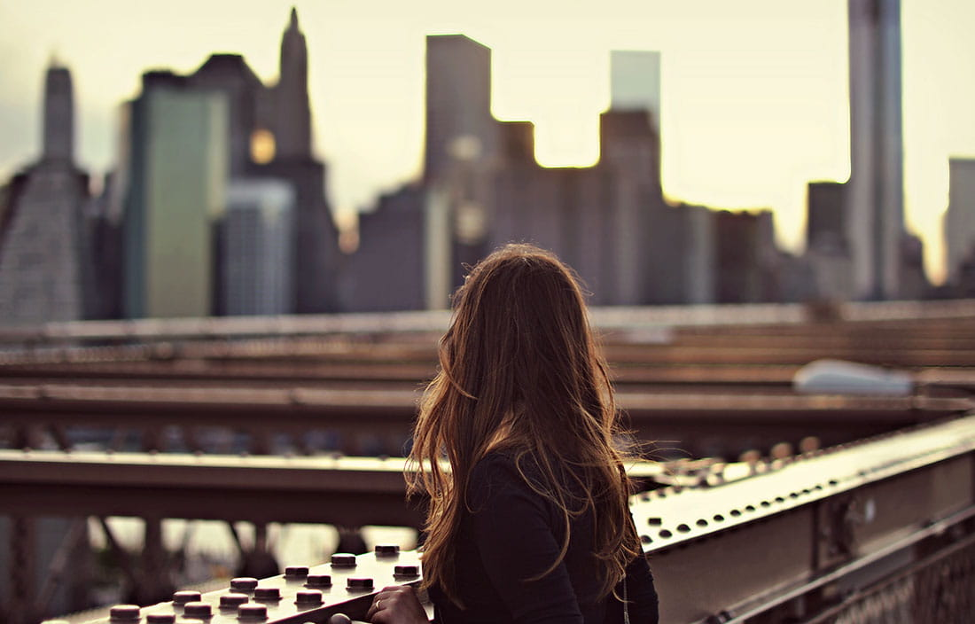 Woman overlooking a cityscape