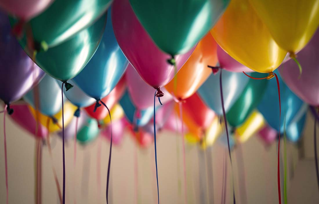 Image of colorful balloons groups together for a celebration of a promotion or new hire