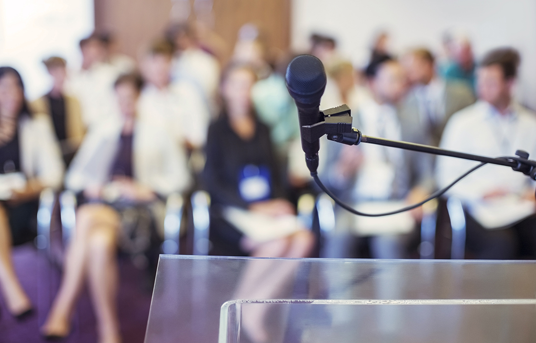 Photo of a microphone at a conference.