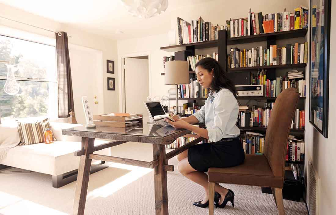 Businesswoman sitting in home office for work.